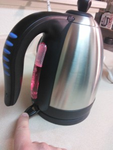 Press switch on electric tea pot and bring to a boil